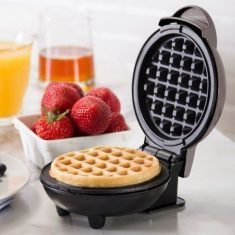 Dash Mini Waffle Maker With A Non-Stick Surface That's Simple To Clean